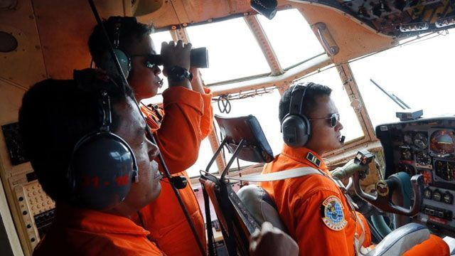 Stormy weather has hindered the efforts of rescuers to recover the victims of AirAsia Flight 8501, even as a seventh body was pulled from the Java Sea Wednesday.