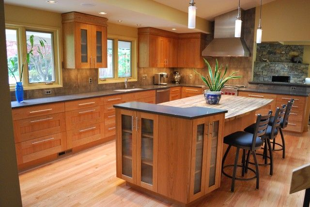 Cherry Wood Cabinets With White Granite Counters And White Island With Butcher Block Top