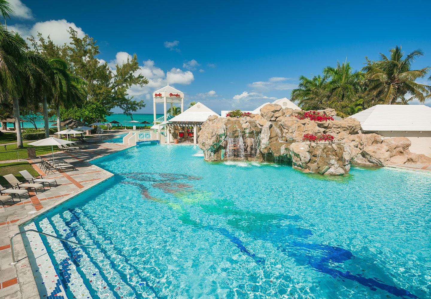 The Pool At Caribbean Village Overlooks Turquoise Seas Beaches