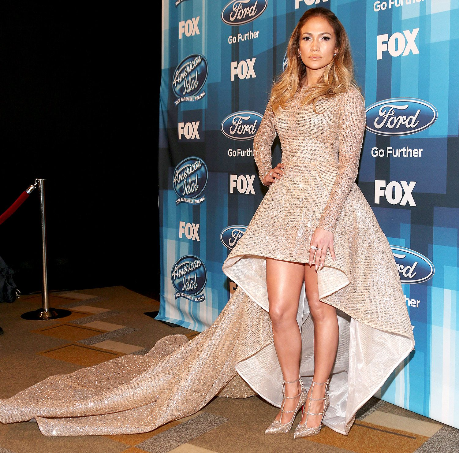 JENNIFER LOPEZ in a sequined champagne-colored Yas Couture high-low gown and Christian Louboutin heels