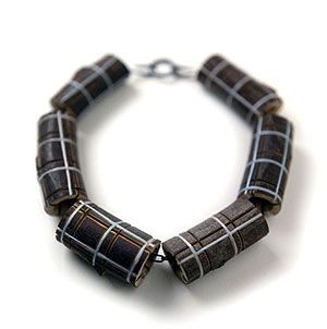 Terhi Tolvanen ~Chanel 2006. Necklace Ø 19 cm. Silver, steel, wood, textile. Collection Rotasa Foundation.