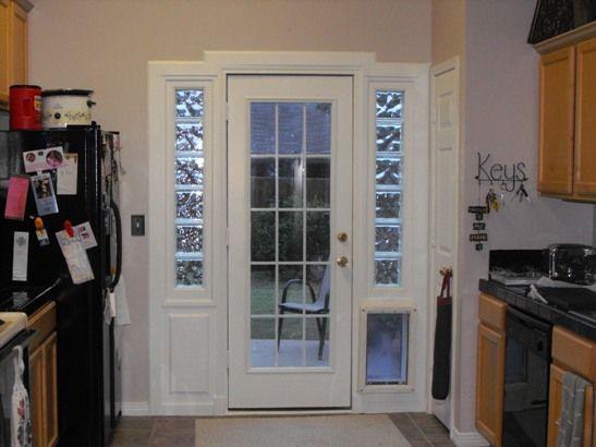Tore out french doors built in door glass block doggie - Exterior french doors with pet door ...