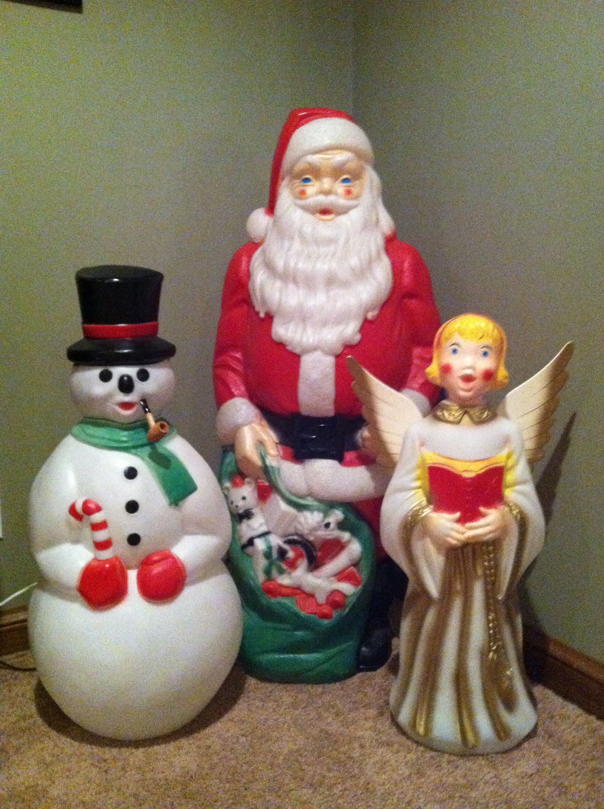 vintage outdoor lighted blow molds of santasnowman and a angel we used to have the santa outside our house