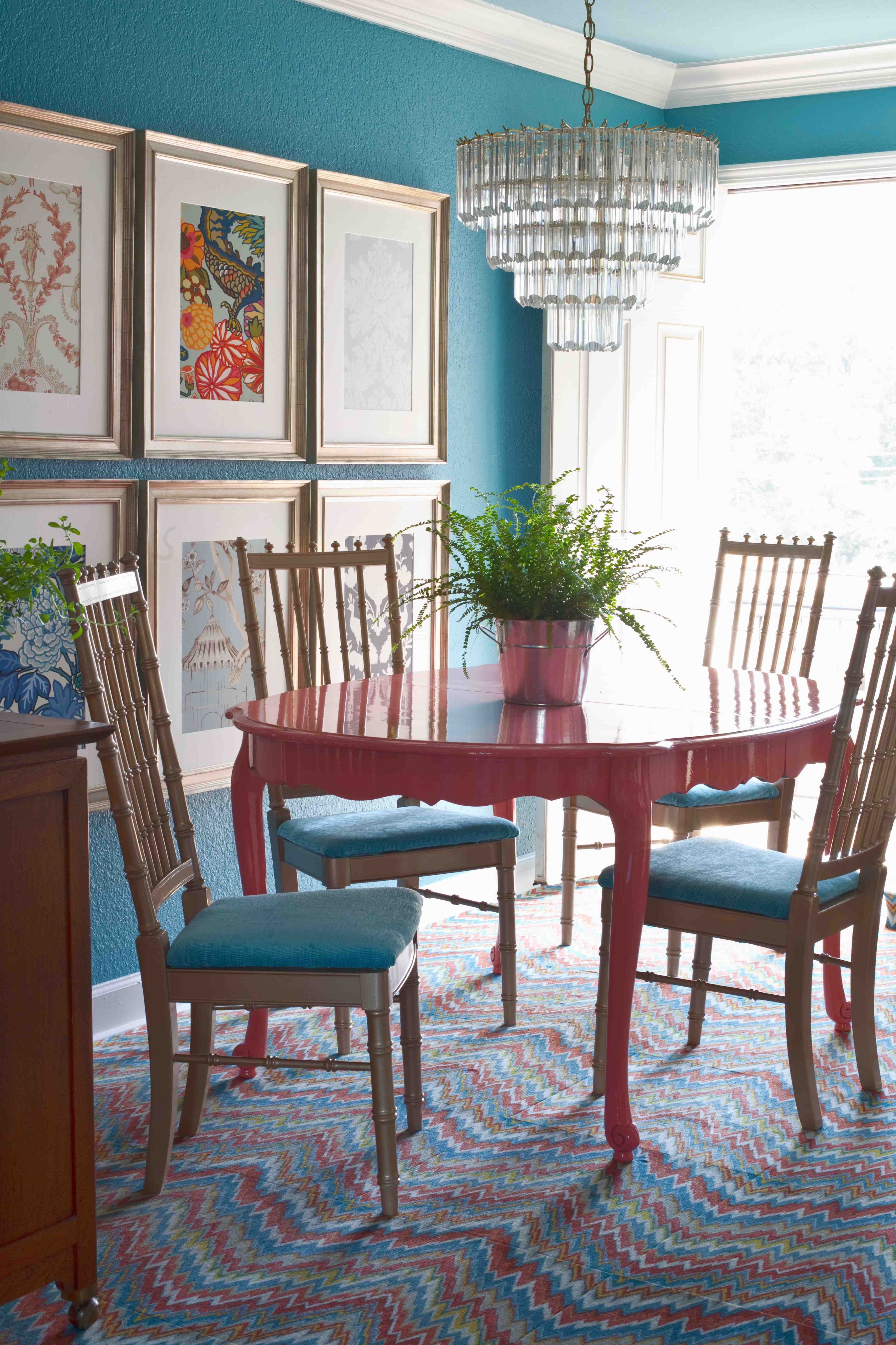 Teal and coral in a dining room with cool framed fabric for Teal dining room table