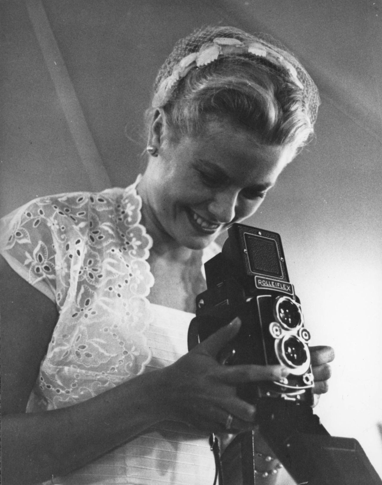 Grace kelly takes a photograph at her sister lizanneus wedding