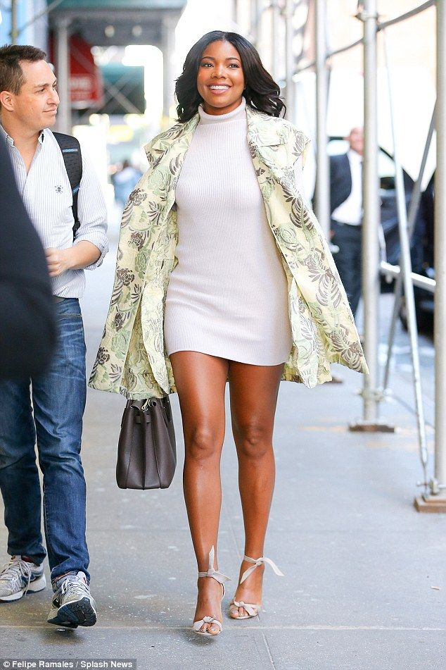 Gabrielle Union shines in a white dress with lace panels ...