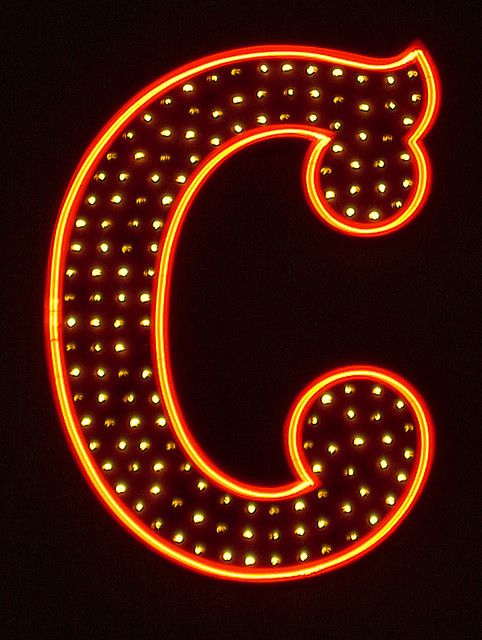 Letter C in neon lights  neon light + other light bulbs is a really nice combination