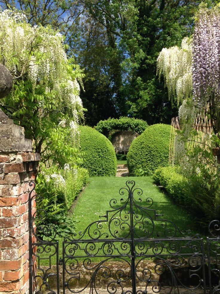 Vista With Wisteria At Heale Beautiful Gardens Sloped Garden Garden Design