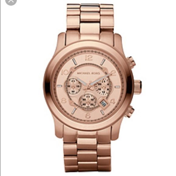 Michael kors large runway watch rose gold Lightly worn, comes with box and links.  Rose gold is the perfect metal tone goes great with everything Michael Kors Accessories Watches