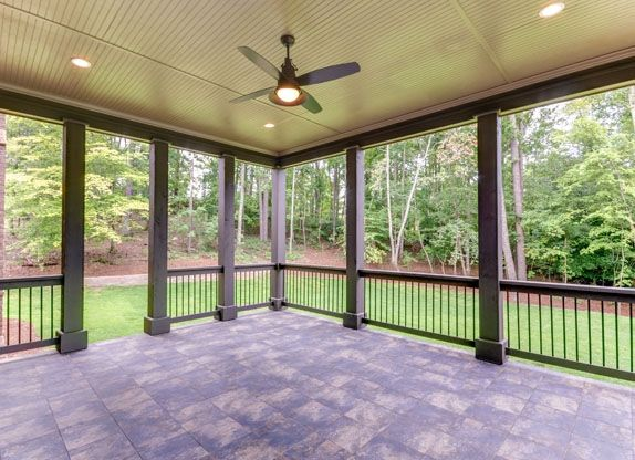 Outdoor covered patio with tile floors.