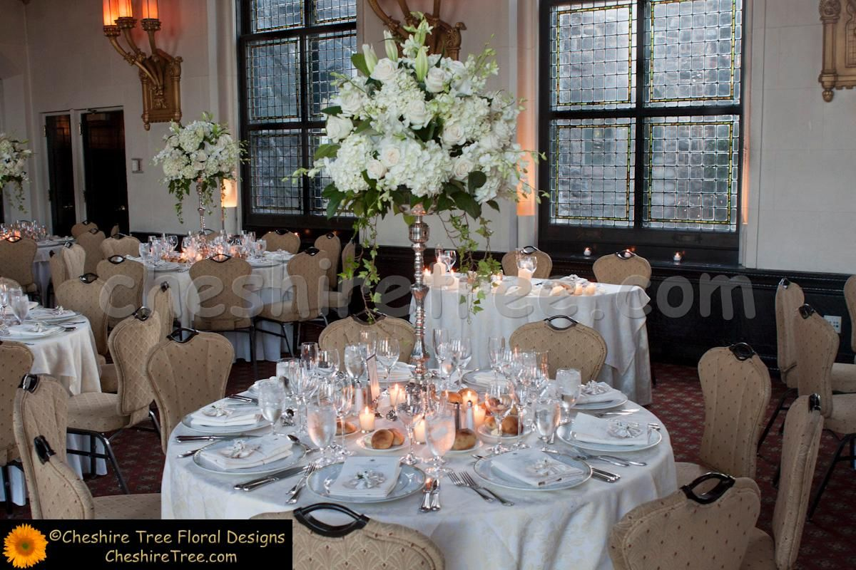Tall Flower Arrangements For Weddings | Tall white flower arrangement surrounded by candles | Wedding Ideas