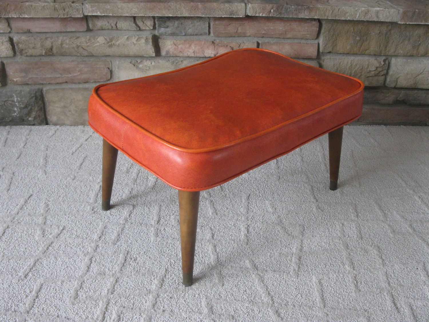 Footstool Mid Century Orange Vinyl Orange Faux Leather Vintage Hassock Ottoman Wood Legs Brass Feet Padded Stool Mad Padded Stool Wood Legs Footstool
