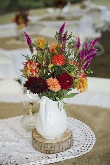 Fall flowers along with burlap sacks, crocheted doilies and vintage oil lamps make a lovely tabletop. We have it all! www.facebook.com/cabincreekantiques. Photo from Jacob and Amanda collection by Megan Travis Photography