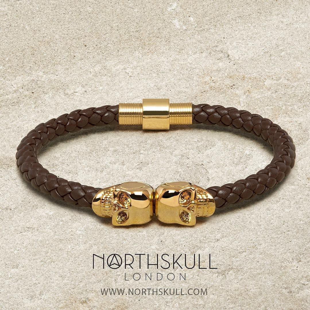 The Brown Nappa Leather / Gold Twin Skull Bracelet by @Northskull is perfect for both formal & casual styles. The rich tones brought together in this piece beautifully complements the wrist creating an excellent blend of style & sophistication | Available now at Northskull.com [Worldwide Shipping] #Luxury #Jewelry #MensFashion