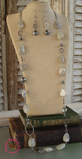 Moonstruck  Luminescent moonstone, antiqued olive green coin pearls, freshwater pearls, Swarovski crystals and hammered silver links, all on stainless steel wire. 33 to 37 inches long (depending where you attach the lobster clasp. Necklace $42, Earrings $12