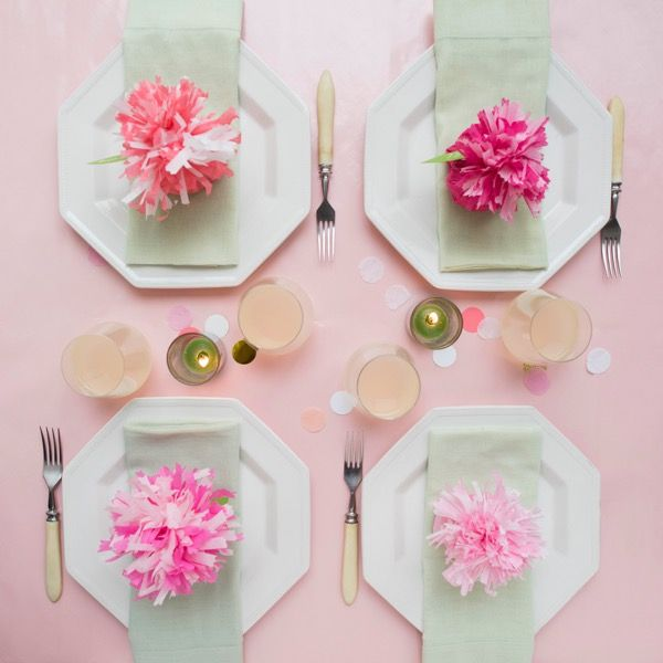 table settings with tissue paper flowers