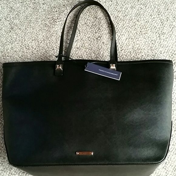 """NWT Rebecca Minkoff Everywhere Tote Black Rebecca Minkoff Everywhere Tote, brand new with tags and dustbag. Measures 16x13 with a 8.5"""" drop. Three large compartments and a zippered pocket. Two smaller inner pockets. Retails for $295. Rebecca Minkoff Bags"""