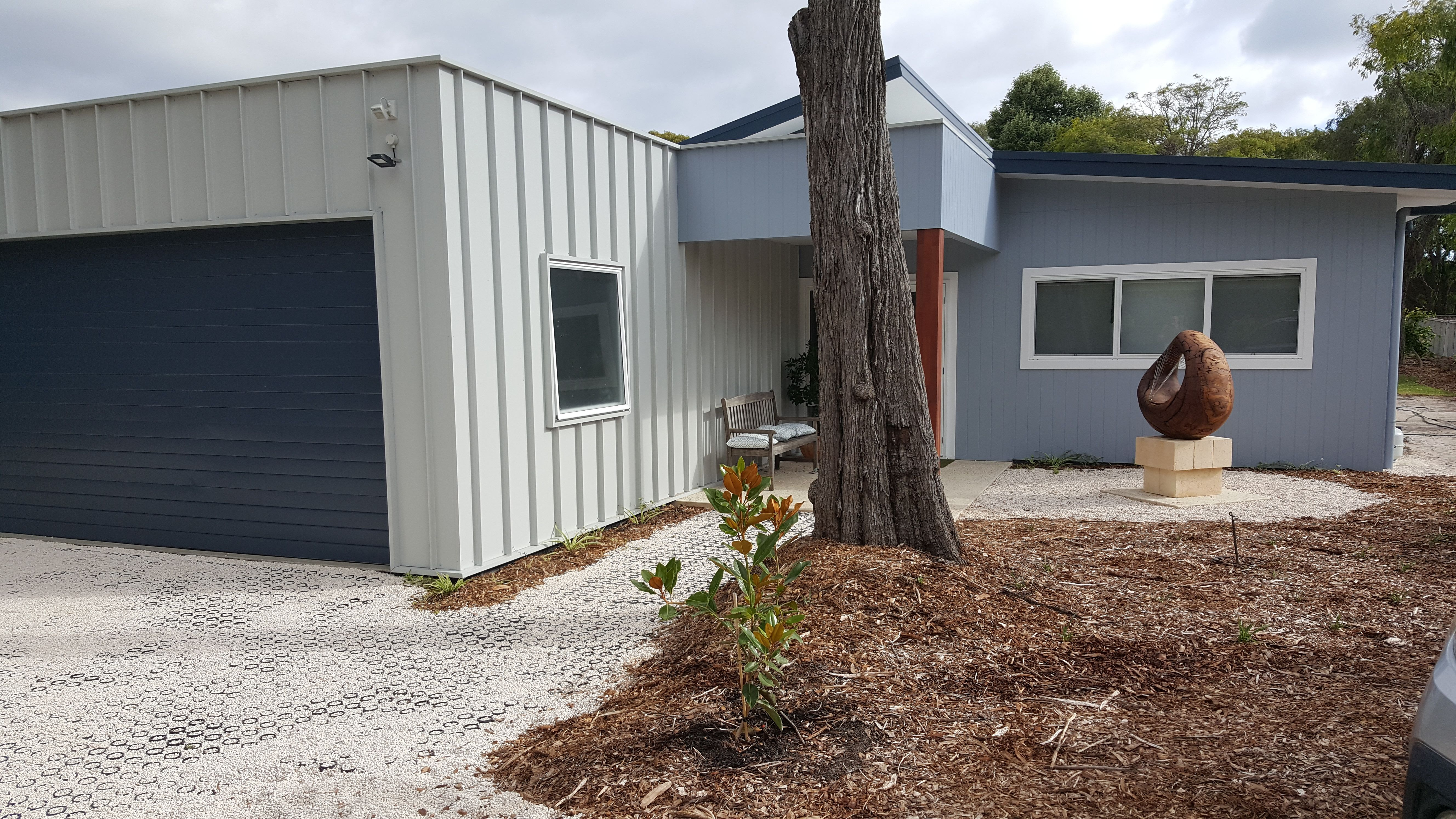 Garage Cladding In Matrix Colorbond In Shale Grey With Deep Ocean Blue Colorbond Sectional Garage Door Hardy A Sectional Garage Doors House Wall Garage Doors
