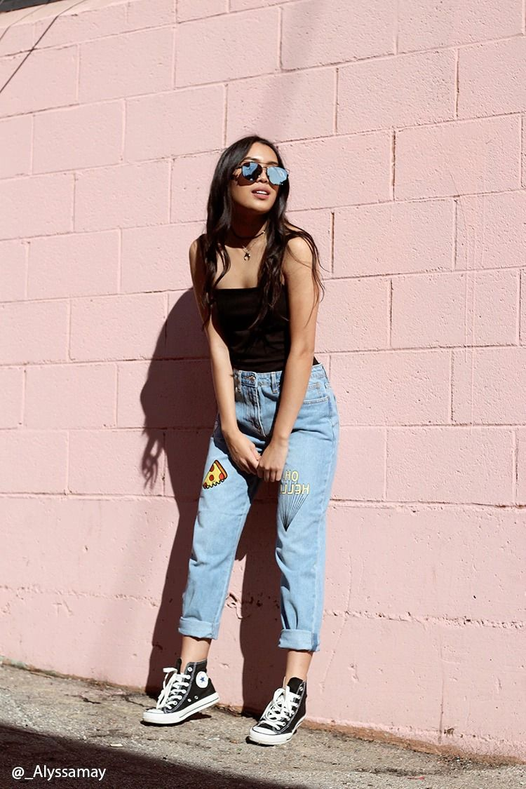 """A pair of denim pants featuring various patches including a diamond, cherries, pizza, and """"Oh, Hello"""", slight distressed design, a five-pocket construction, and a zip fly."""