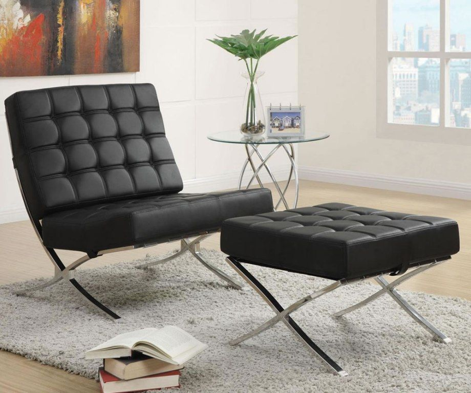 Black modern accent chair with matching ottoman accent