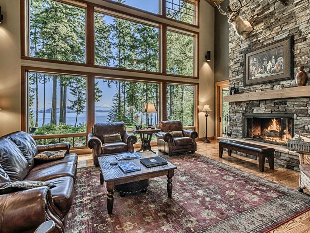 The 24 ft. wall of windows and Great Room look over the