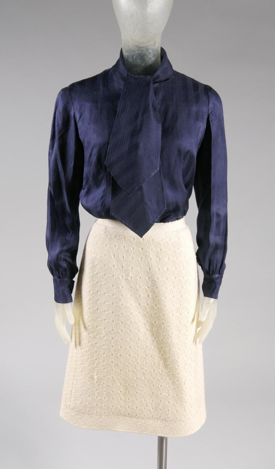 Woman's suit: jacket, skirt, blouse and tie | Designer: Hubert de Givenchy | France, 1968 | Materials: ivory wool, blue silk | Philadelphia Museum of Art
