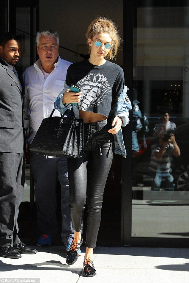 Gigi Hadid wears personalized denim jacket and skintight leather pants
