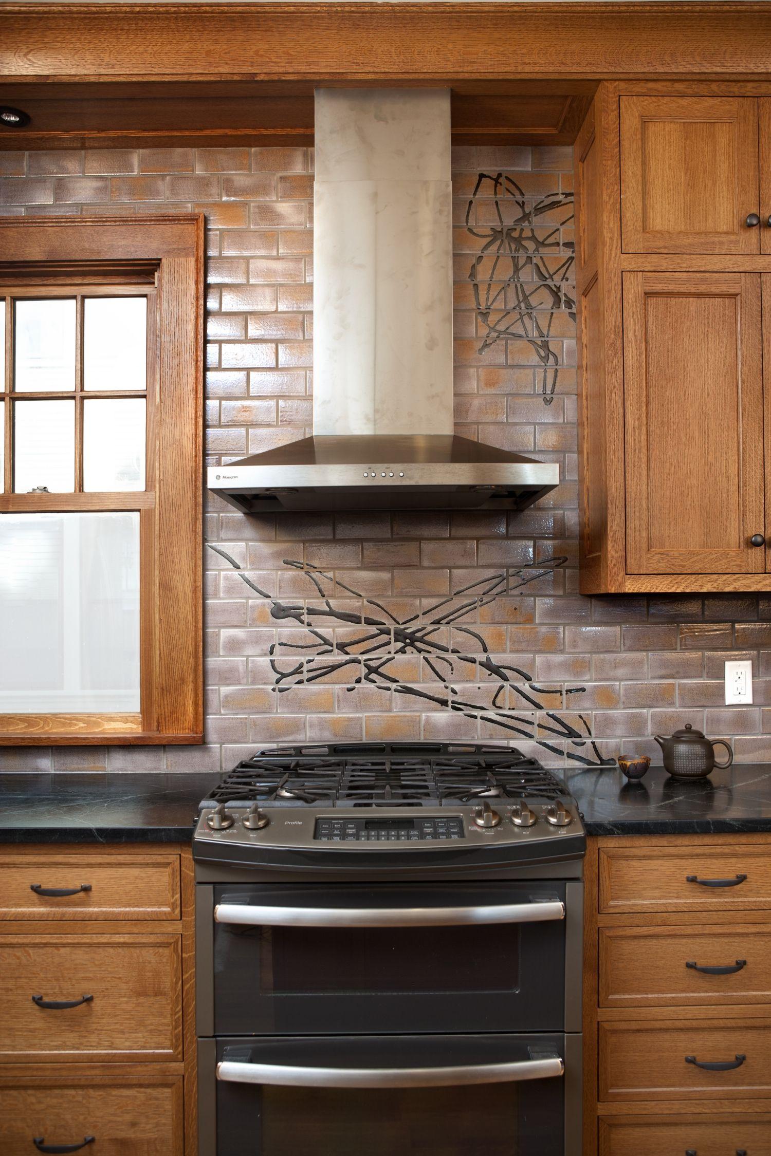 this expressive kitchen backsplash is a blend of two colors rh pinterest com