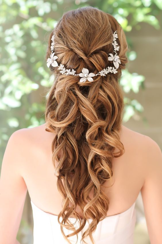 Hairstyle With Curly Hair And A Crown With Flowers Elegant