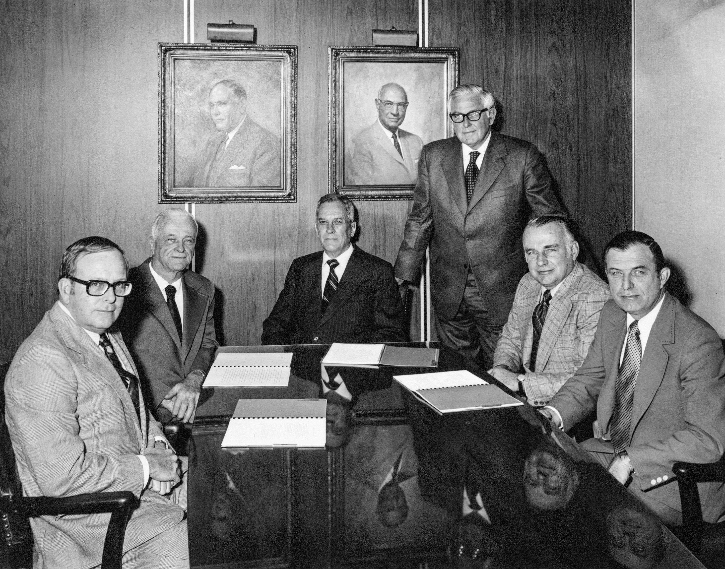 Upon Veatch's retirement, Tom Robinson (standing) became