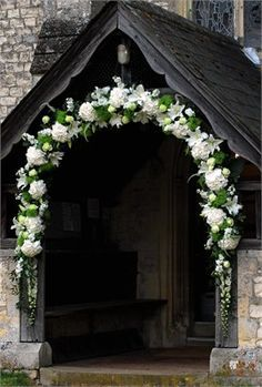 An arch decorating the entrance to a church carolina pinterest an arch decorating the entrance to a church wedding flowerswedding junglespirit Choice Image