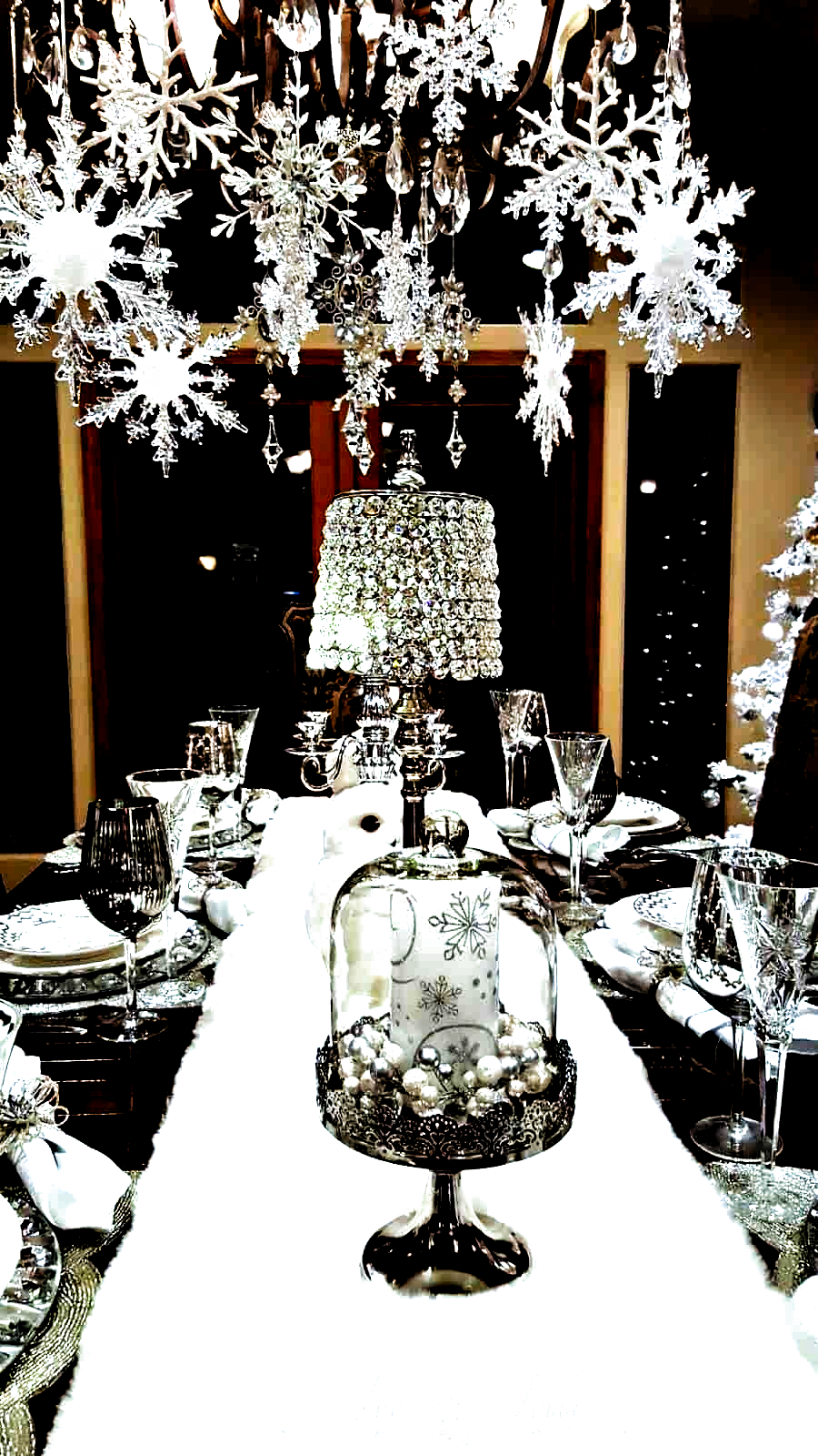 Easy DIY hanging snowflake winter decor idea using dollar store snowflakes and ribbon. This would be elegant as a Christmas decoration or at a winter wedding. A lot of great budget decor ideas for the home, winter wedding, or Christmas party. #ChristmasDecorationIdeas #Christmas #wedding #ChristmasParty #christmasdecordiy