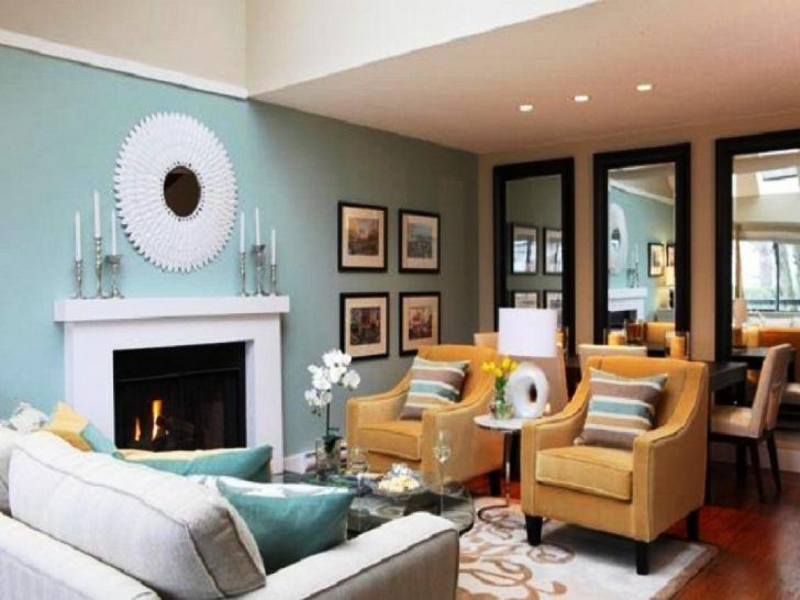 Living Room Decorative Oval Wall Mirror And Candles Lamp Above