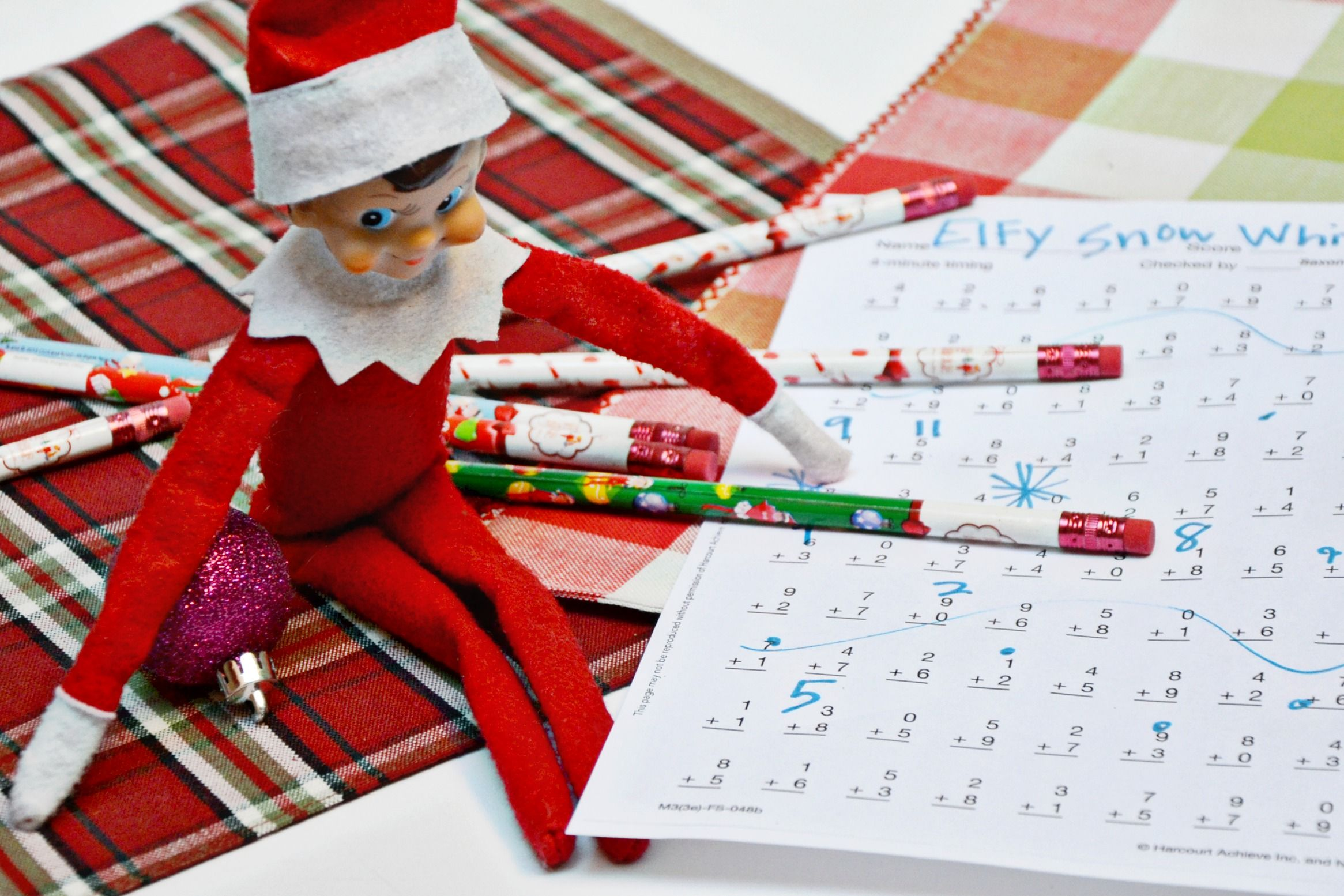 This easy Elf on the Shelf idea is awesome! Make a copy of your child's homework before your elf tries to help. Elf on the Shelf pencils from @orientaltrading make homework fun! #orientaltrading #elfontheshelf #ad