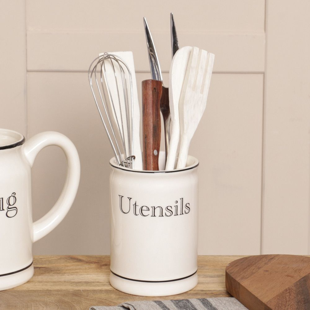 Finished in a rich cream colour, this ceramic utensils pot is the ...