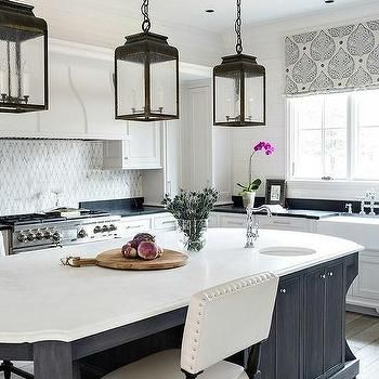 Black Oval Kitchen Island With Honed White Marble Countertops