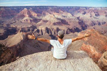 USA Arizona man enjoying the view at Grand Canyon back view
