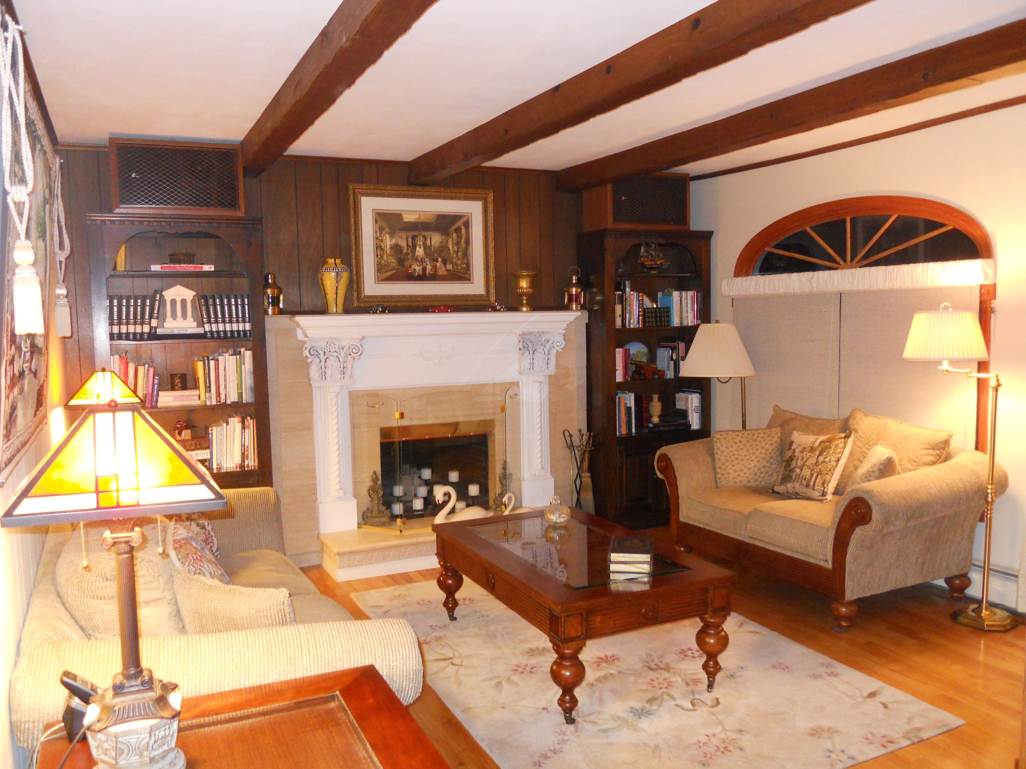 Family Room with Wood Floors and Toasty Warm Marble Fireplace and French Doors leading to 2 tier trex/wood deck.