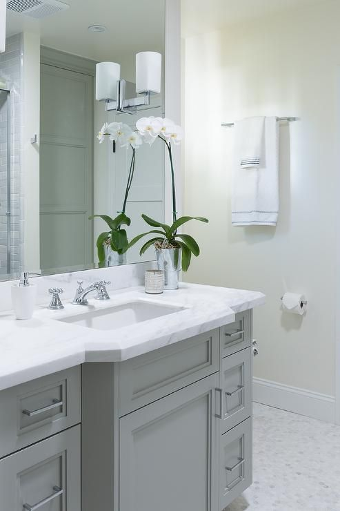 astonishing white bathroom vanity grey tile | Elegant bathroom features a gray curved vanity topped with ...