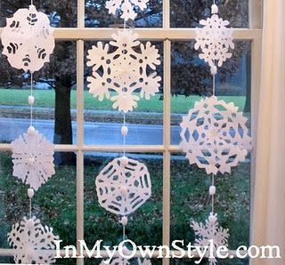 "DIY snowflake garland - easy (uses coffee filters and ""snowball"" yarn).  Also links to snowflake patterns."