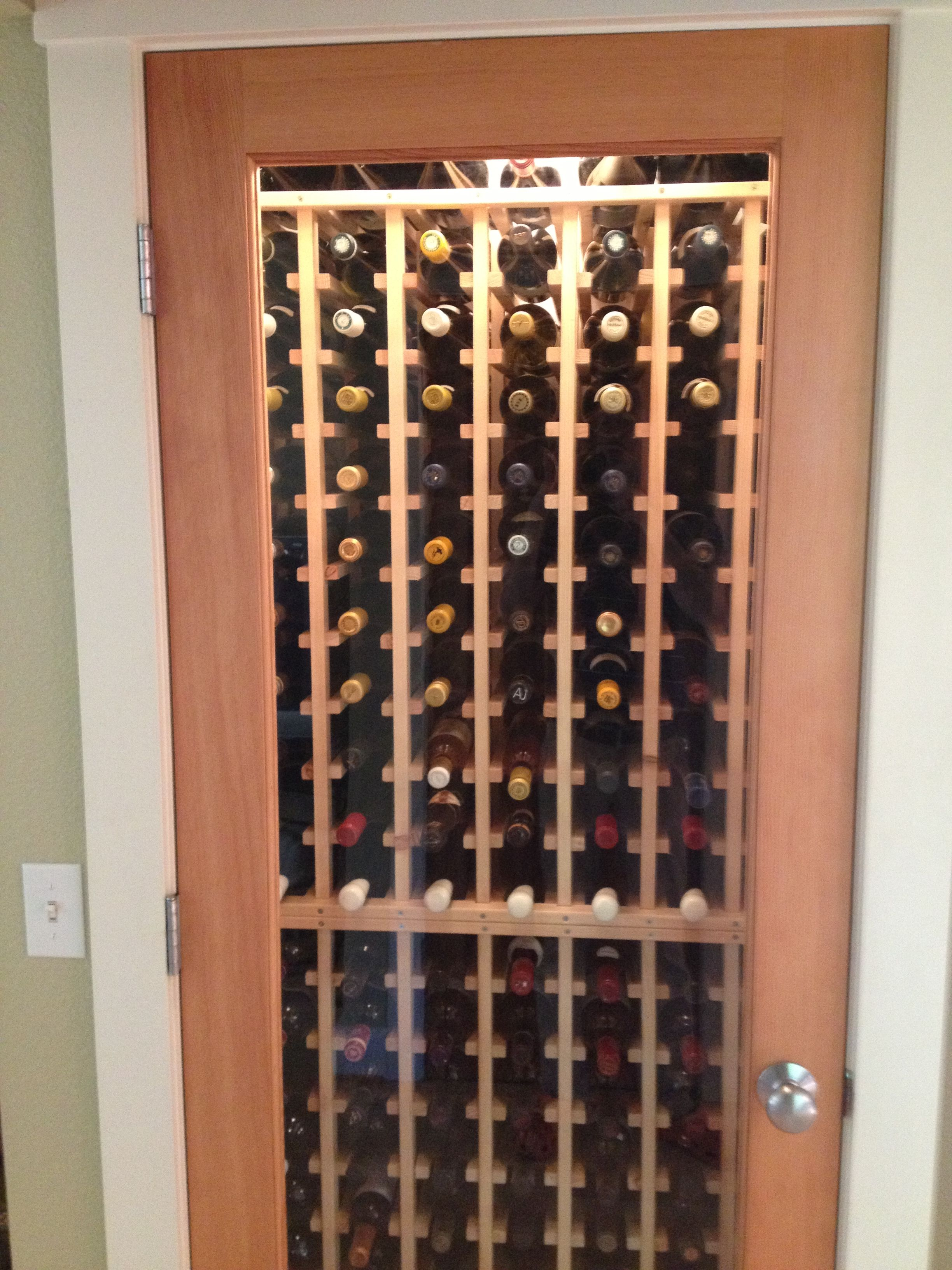 no space is too small for a wine cellar! here is a customer's closet