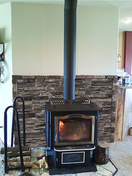A Faux Stone Accent Wall Makes A Great Finishing Touch Behind Cast Iron Stoves Or On Any Wall Of Your H Wood Stove Surround Faux Stone Walls Stone Accent Walls