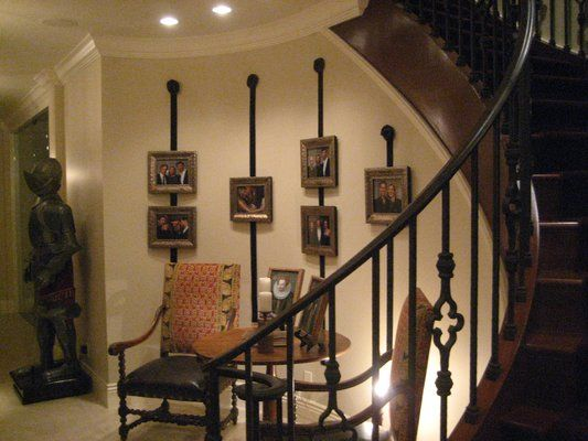 Chic Ways To Decorate Your Staircase Wall: Ribbon Hung On A Curved Wall, Good Way To Decorate The