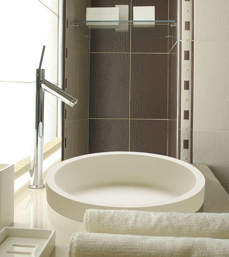 Halo 1 SR is a round semi-recessed bathroom sink, which allows only ...