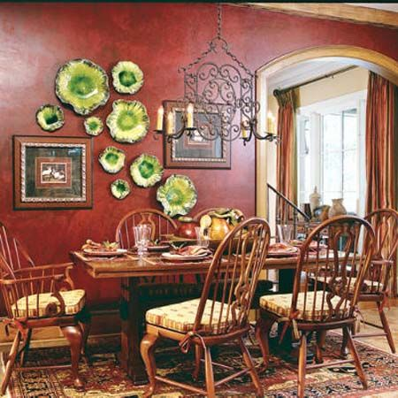 green plates work well with artwork in this dining room | wall