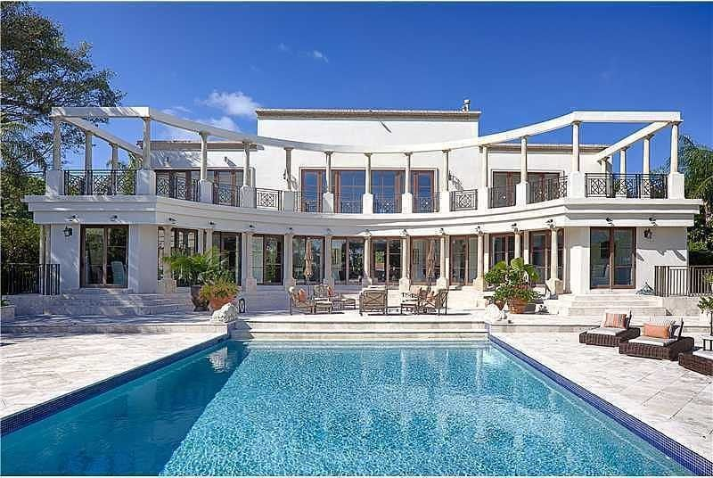 This Classical Ish Indian Creek Estate Is 19 8 Million Mansions Luxury Beach House Miami Beach Real Estate