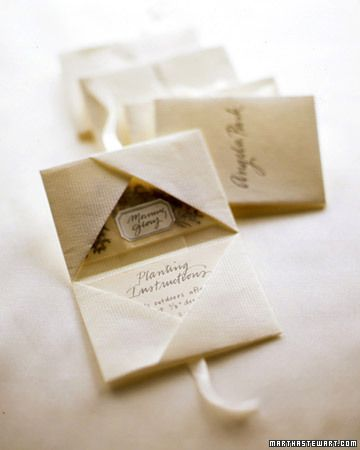 from martha stewart: origami packets with seed packets as party favors