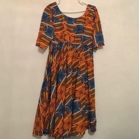 African print dress Multi- color African print dress with a side zipper and v- design in the back. Colors are blue, olive green, orange, and burgundy. Size medium. Bust 36. Waist 42. Handmade Dresses Midi