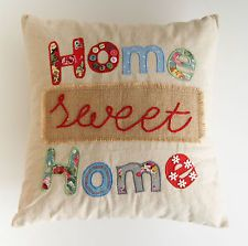 I like this because it is simple and i like the quote on it and the patterns. The formal elements that have been included on this applique pillow are space, pattern, colour and line.