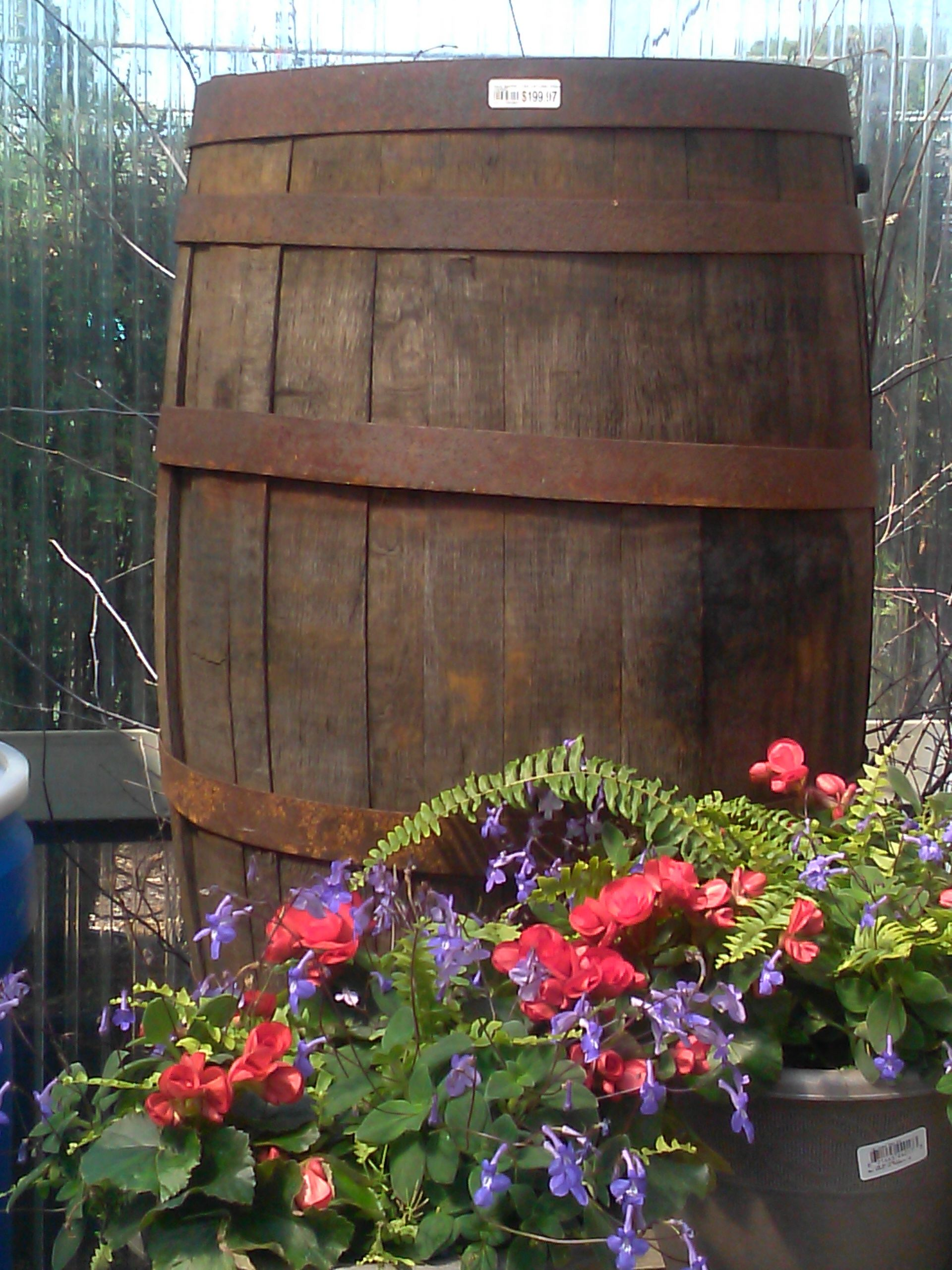 Whiskey rain barrel with flowers | Books Worth Reading | Pinterest ...